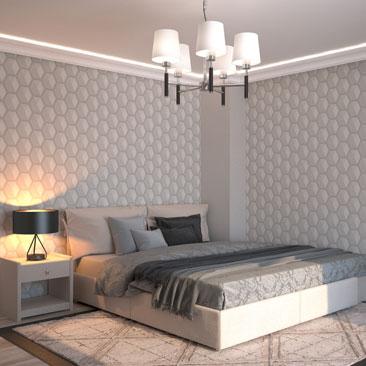 Спальня с серыми обоями и кроватью возле стены.